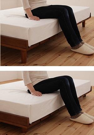 高いベッドに座る